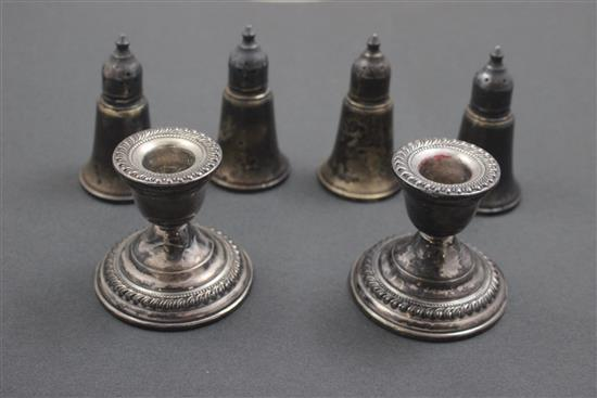 4 WEIGHTED STERLING SILVER SALT AND PEPPERS AND PAIR LOW CANDLE HOLDERS, 2 1/2