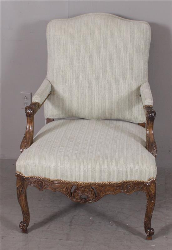 OPEN ARM CHAIR WITH FLORAL AND LEAF CARVING, GREEN UPHOLSTERY, AND NAILHEAD TRIM, 41