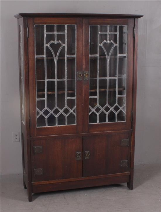 OAK ARTS AND CRAFTS CHINA CABINET WITH ORIGINAL HARDWARE AND RE-LEADED GLASS IN DOORS, 45
