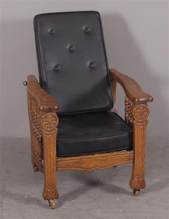 CHILD'S SIZE OAK MORRIS CHAIR WITH BLACK VINYL CUSHIONS, 20
