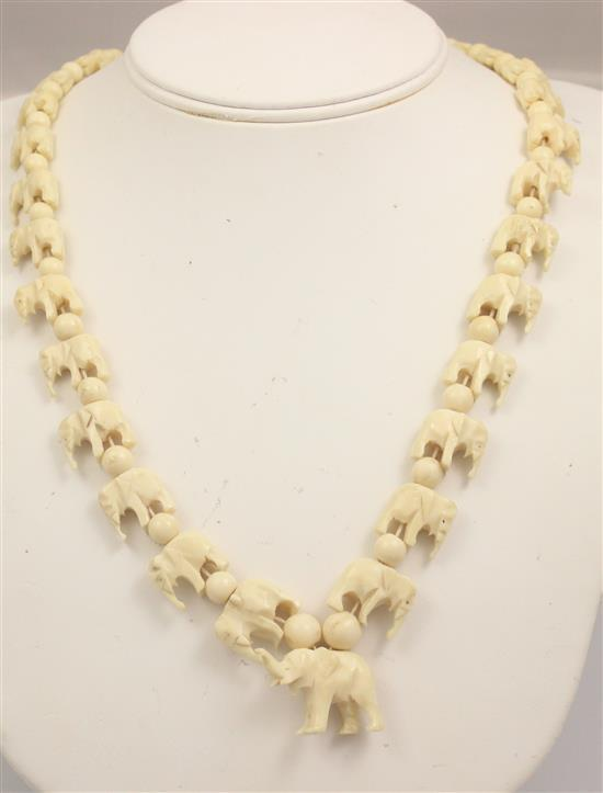 CARVED IVORY ELEPHANT DESIGN BEAD NECKLACE, 23