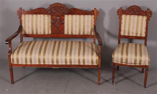 2 PIECE VICTORIAN PARLOR SUITE INCLUDING SETTEE AND CHAIR WITH APPLIED CARVING AND STRIPED UPHOLSTERY, SETTEE 45