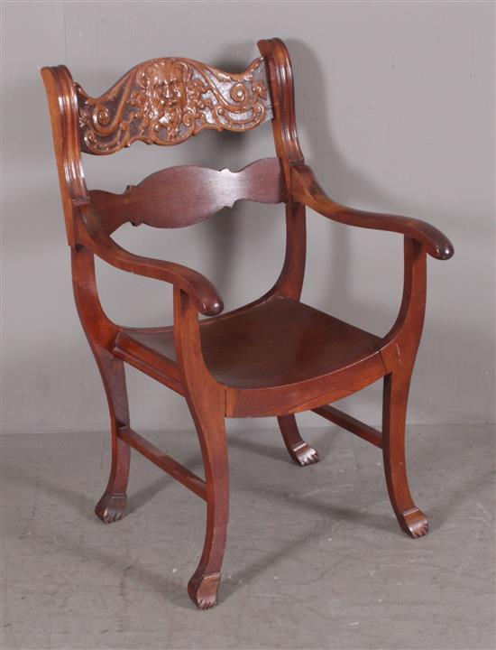 MAHOGANY ARM CHAIR WITH OLD MAN OF THE NORTH BACK, 23