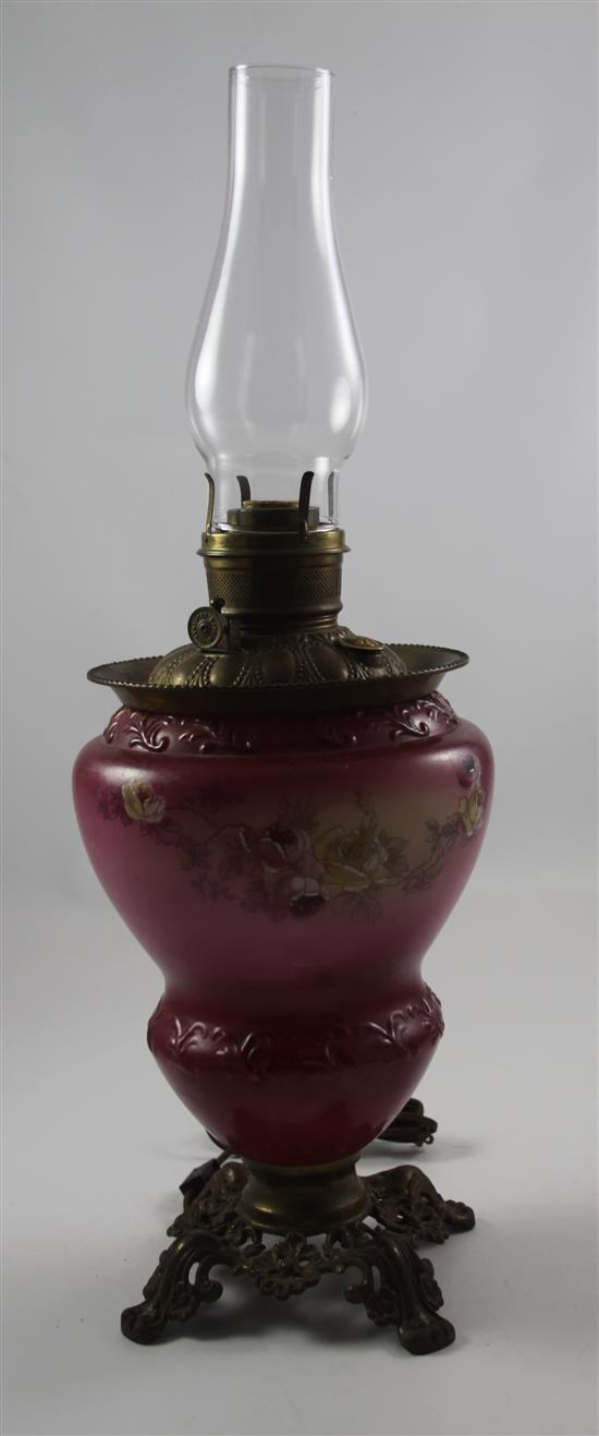 VICTORIAN OIL LAMP ON ORNATE METAL BASE WITH CRANBERRY FONT, PAINTED ROSE DECOR, ELECTRIC
