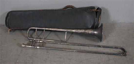 SILVER TROMBONE AND VINTAGE LEATHER CASE