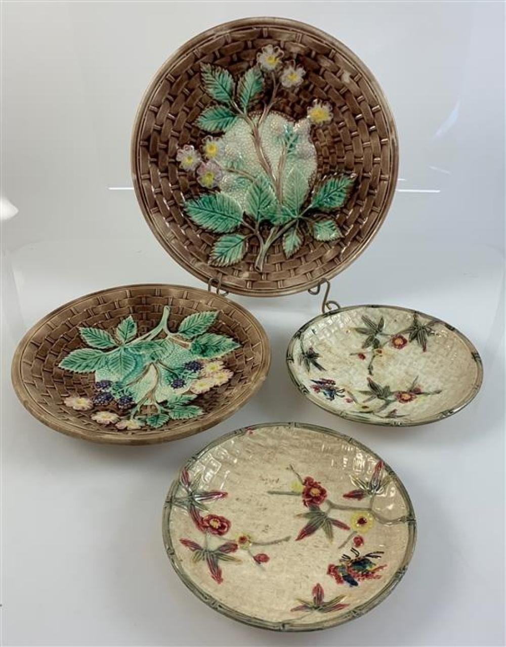 """4 MAJOLICA BASKETWEAVE PATTERN PLATES - (2) 6¼"""" CREAM COLORED WITH FLORAL DECOR, 8"""" AND 9¼"""" BROWN WITH LEAVES, BERRIES, FLOWERS"""