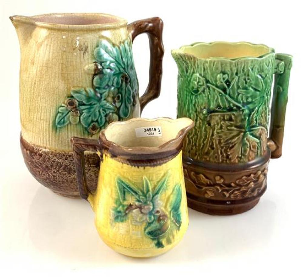 """3 MAJOLICA PITCHERS - 4½"""" YELLOW WITH FLORAL PATTERN, 6½"""" GREEN AND BROWN WITH LEAF PATTERN, 7½"""" YELLOW AND BROWN WITH LEAVES AND BE..."""