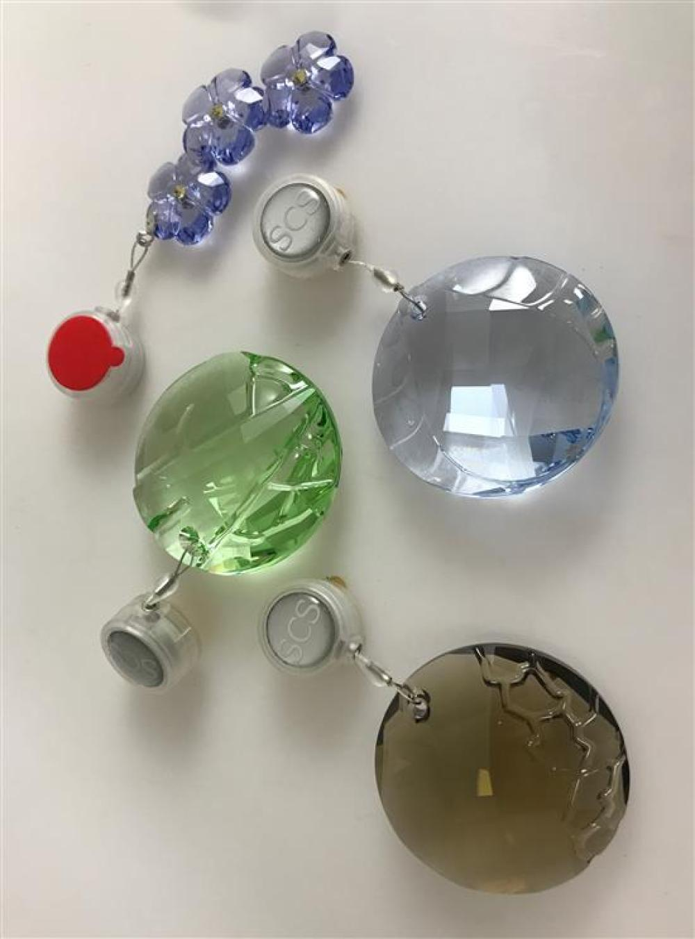 """4 SWAROVSKI CRYSTAL SUN CATCHERS IN BLUE, GREEN, AMETHYST AND SMOKEY GREY. CRYSTALS ARE 2."""" ORIGINAL BOXES INCLUDED"""
