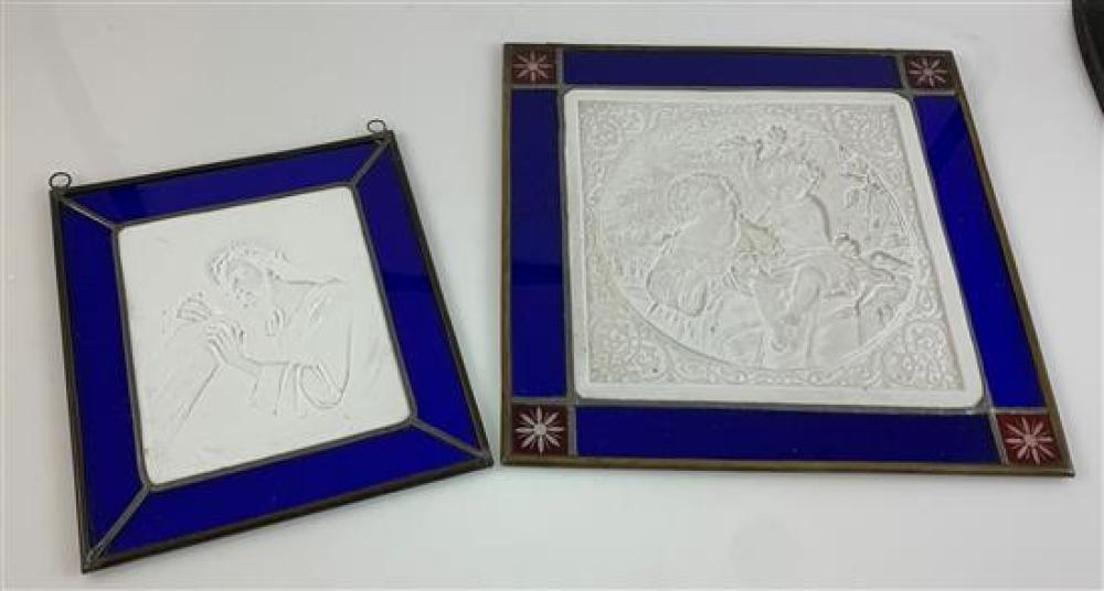 """2 LITHOPHANE PANELS IN BLUE LEADED GLASS FRAMES - 6½""""x 7"""" DEPICTING CHRIST CARRYING THE CROSS AND 9¼""""x 9¼"""" DEPICTING LITTLE GIRL AND..."""