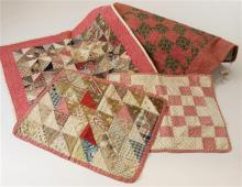 4 PIECED DOLL QUILTS, RED AND BROWN PINWHEEL, RED AND CREAM BLOCK, HALF SQUARE TRIANGLE AND EARLY SAWTOOTH AND SQUARE, 10.5