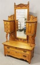 TURN OF THE CENTURY OAK CHEVAL DRESSER WITH HAT BOX AND MIRROR AND APPLIED CARVING, 45