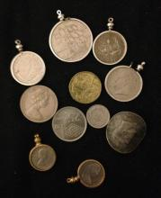 LOT 10 FOREIGN COINS INCLUDING 6 IN BEZELS