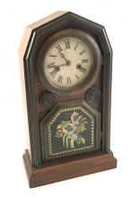 WELCH, SPRING, & CO THIRTY HOUR BRASS CLOCK WITH REVERSE PAINTED TABLET, 16
