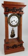 PORTICO MANTEL CLOCK WITH ENAMEL DIAL AND APPLIED CARVINGS, 27