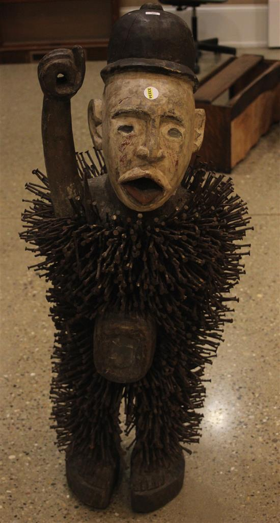 AFRICAN NKISI NKONDI (GUARDIAN / HUNTER OF EVIL) WOODEN FIGURIENE, COVERED IN SEVERAL HUNDRED NAILS, APPROXIMATE 45 INCHES TALL, FEA...