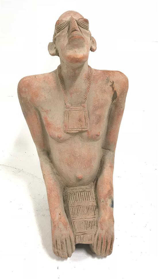 AFRICAN ART, STATUE MADE OF RED CLAY, FIGURE IS OF A MAN WITH HIS HEAD TILTED TO THE SUN, POSSIBLY IN PRAYER, FROM THE DJENNE TRIBE,...
