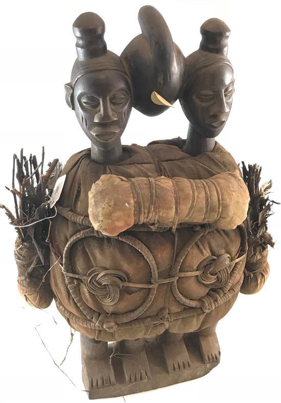 AFRICAN TRIBAL ART, WOODEN DOLL WITH THREE HEADS , WRAPPED IN CLOTH, FEATHERS AND STICKS, POSSIBLY FROM THE YAKA OR TEKE TRIBE, 23....