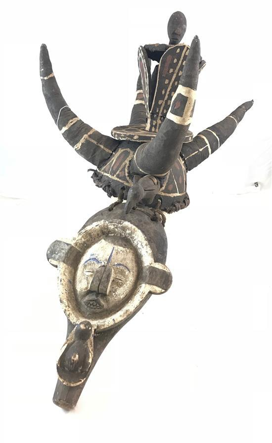 AFRICAN MASK AND HEADDRESS , FROM THE YAKA TRIBE, THE HEADDRESS FEATURES 4 LARGE HORNS MADE OF FABRIC AND A TALL WOODEN TOPPER. THE WO.