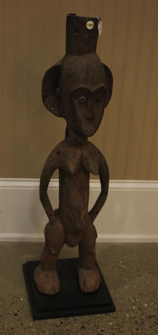AFRICAN ART WOODEN SCULPTURE OF A FEMALE, HANDS ARE PLACED ON HIPS WITH LARGE ROUNDED EARS, CLOSED MOUTH , PREGNANT BELLY, & HAS SEV...