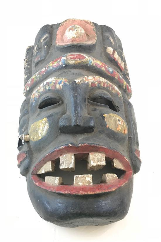AFRICAN MASK, MADE OF WOOD, FEATURING 5 FACES, MOSTLY PAINTED IN RED, BLACK AND WHITE WITH LARGE TEETH, 21