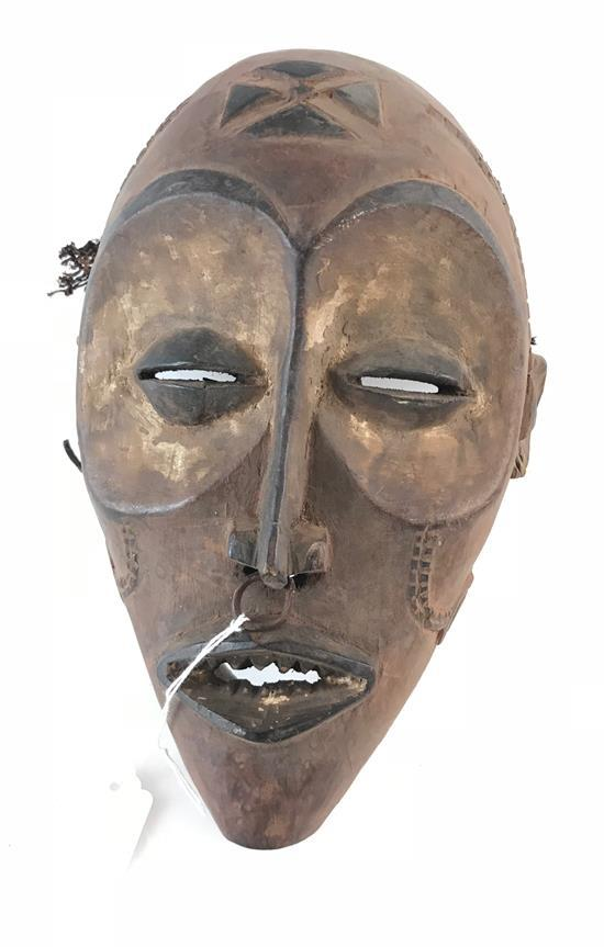 AFRICAN MASK MADE FROM WOOD, FEATURING BRASS JEWELRY, AND STRAW LIKE HAIR, 10