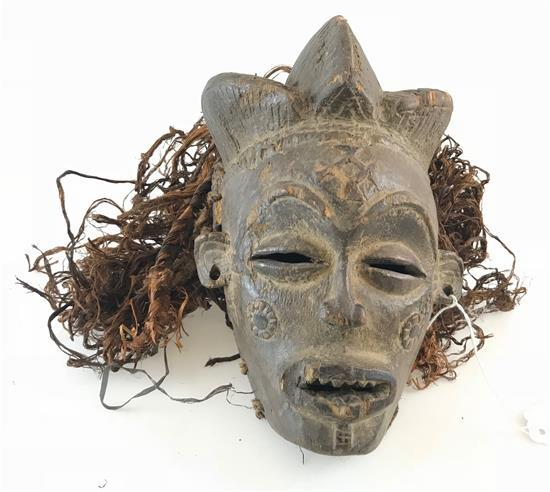 AFRICAN MASK MADE FROM WOOD, FEATURING PIERCED EARS FOR JEWELRY, AND STRAW LIKE HAIR, APPROXIMATELY 10