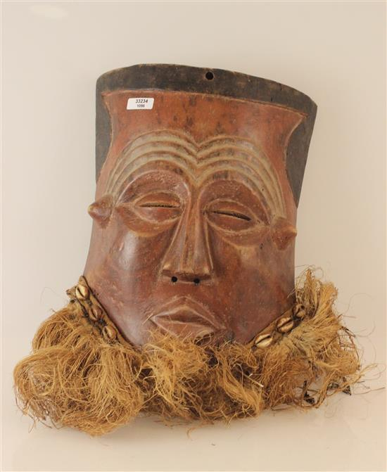 AFRICAN MALE MASK FEATURING A GRASS BEARD, DETAILED WITH SEA SHELLS, PAINTED RED & BLACK. 11