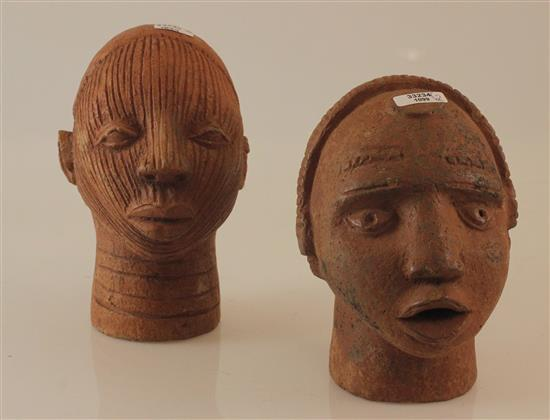AFRICAN TERRACOTTA ART, TWO SHRINE HEADS MADE FROM RED CLAY, POSSIBLY IFE, RIDGES IN FACE REPRESENT THE SACRIFICE AND OR SCARIFICATI...