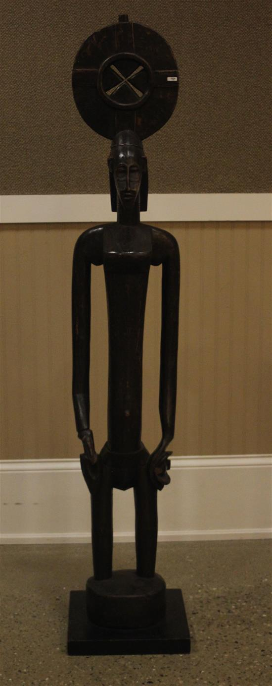 AFRICAN ART, WOOD CARVING OF WOMEN, WEARING A ROUND HEADDRESS HANDS ARE PLACED AT HER SIDES, CUSTOM BASE IS ATTACHED AT THE BOTTOM, A..
