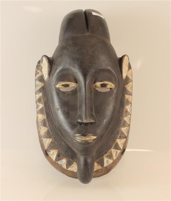 AFRICAN WOODEN MASK, YOHURE STYLE DEPICTING A GOAT, USED DURING FUNERALS TO HELP GUIDE THE DEAD TO THEIR FINAL RESTING PLACE, MASK I...