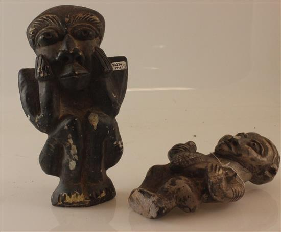 AFRICAN TRIBAL ART, TWO STONE CARVED FIGURES WITH SMOOTH TEXTURE, THE LARGER OF THE TWO HAS AN EXSPRESSION OF BOREDOM WITH HANDS PL...
