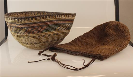 AFRICAN ART, HAND WOVEN BASKET AND BAG. THE BASKET IS WEAVED IN A FURCATE PATTERN AND HAS COLORS OF GREEN, BROWN, TAN AND RED, THE B...