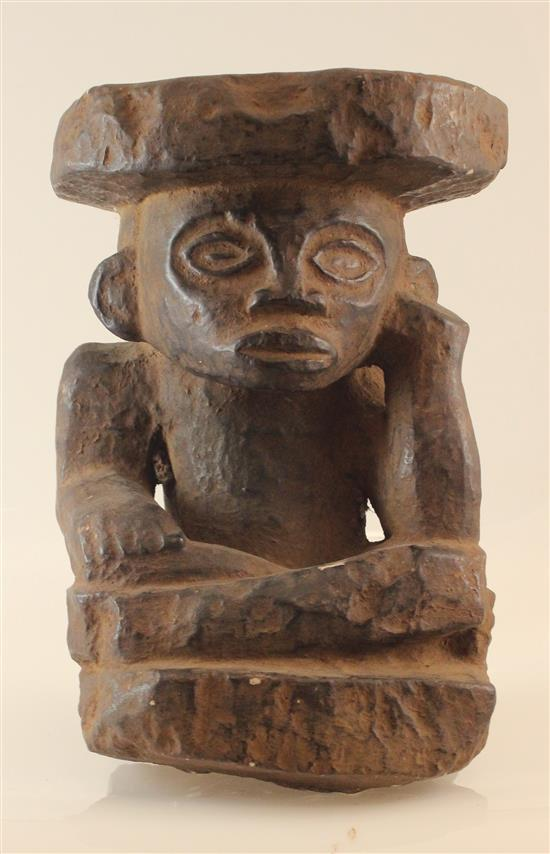 AFRICAN ART, HAND CARVED STONE STOOL, THE STOOL BASE IS OF A MAN HOLDING THE STOOL ON TOP ABOVE HIS HEAD WITH ONE HAND.