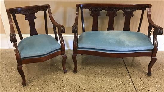 TWO PIECE CARVED MAHOGANY PARLOR SET INCLUDING LOVESEAT AND CHAIR, LOVESEAT IS 41