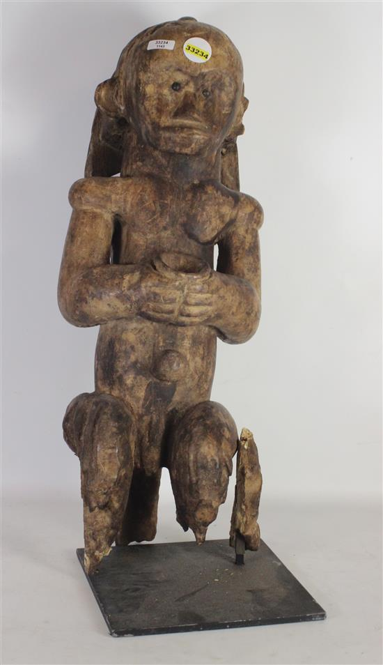 AFRICAN FANG STATUE, A SIMPLISTIC SCULPTURE HAND CARVED FROM WOOD, FIGURE IS SEATED & HOLDING AN OFFERING BOWL, CHARACTERISTIC OF T...