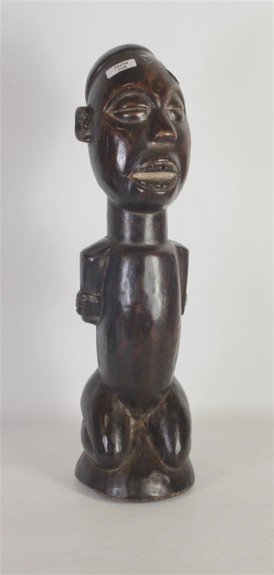 AFRICAN TRIBAL ART, HAND CARVED WOODEN BAKONGO POWER FIGURE, ARMS ARE CROSSED BEHIND THE BACK AND BOUND TOGETHER, MOUTH IS OPEN, EYE...