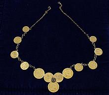 MISCELLANEOUS FOREIGN GOLD COIN CHARM NECKLACE INCLUDING FRANCS, MARKS, PESOS, AND U.S. ONE DOLLAR GOLD COIN ON 14K CHAIN 33.7 GRAMS TW
