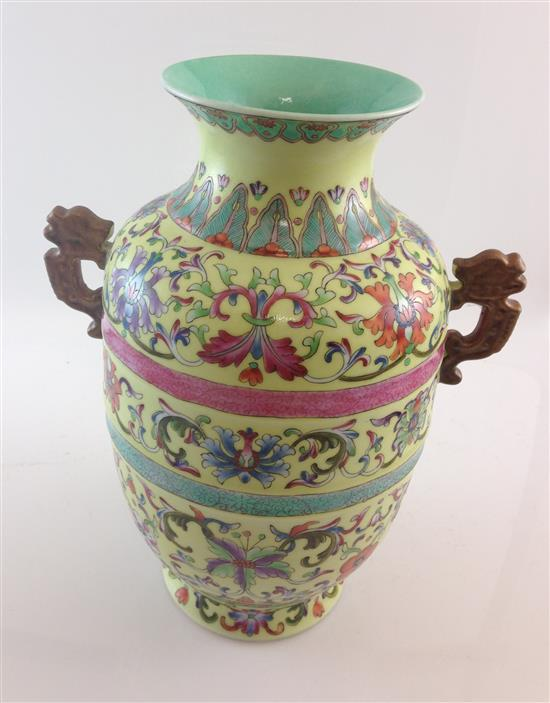 CHINESE PORCELAIN URN WITH YELLOW BACKGROUND AND FLORAL DECOR, 12