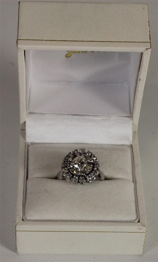 20 STONE DIAMOND HALO RING WITH PRONG MOUNTED OLD EUROPEAN CUT CENTER STONE IN ILLUSION SETTING ON SIZE 5.5 PLATINUM SHANK.