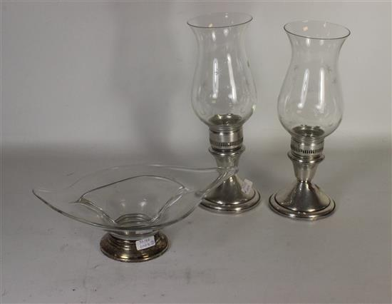 THREE STERLING AND GLASS PIECES INCLUDING: PAIR STERLING WEIGHTED AND REINFORCED CANDLESTICKS WITH GLASS FROM FRANK M. WHITING, AND...