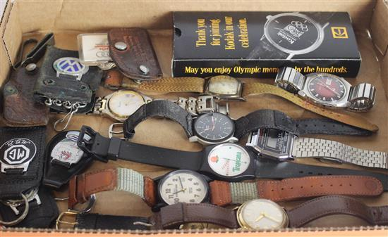 BOX LOT WATCHES AND FOBS INCLUDING: ASSORTED VOLKWAGEN KEY FOBS, WATCHES FROM BULOVA, GRUEN, ACCUTRON BY BULOVA, KODAK, AND TIMEX