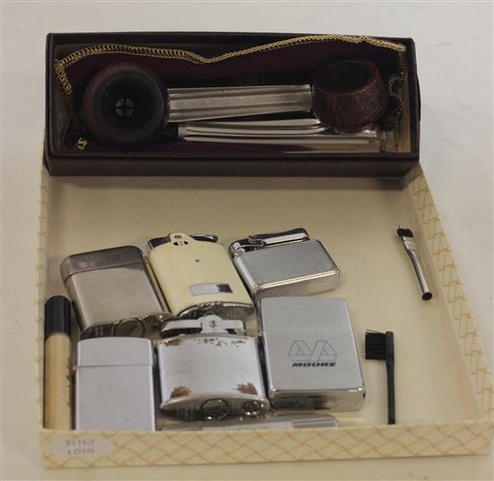 LOT LIGHTERS AND PIPES INCLUDING: LIGHTERS FROM ZIPPO, KREISLER, RONSON, AND THORENS, AND A PAIR OF METAL AND WOOD PIPES FROM KIRSTEN