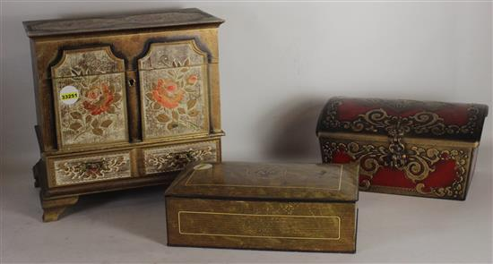 BOX LOT OF THREE MUSIC BOXES INCLUDING: METAL WITH FAUX WOOD GRAIN, RED WITH CURVED TOP, AND ROSE MOTIF