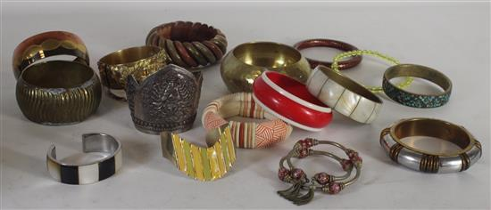 BOX LOT ASSORTED BANGLES INCLUDING: SILVER TONE SHIVA CUFF, HAMMERED GOLD TONE CUFF WITH FLORAL MOTIF, AND A GOLD TONE BANGLE WITH M...