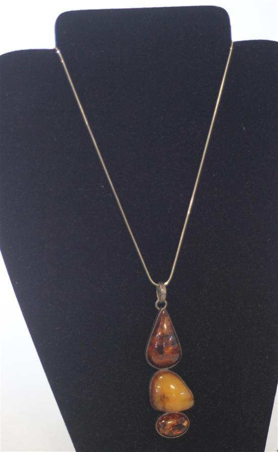 STERLING AND AMBER TIERED DROP PENDANT WITH THREE BEZEL SET AMBER CABACHONS ON 24
