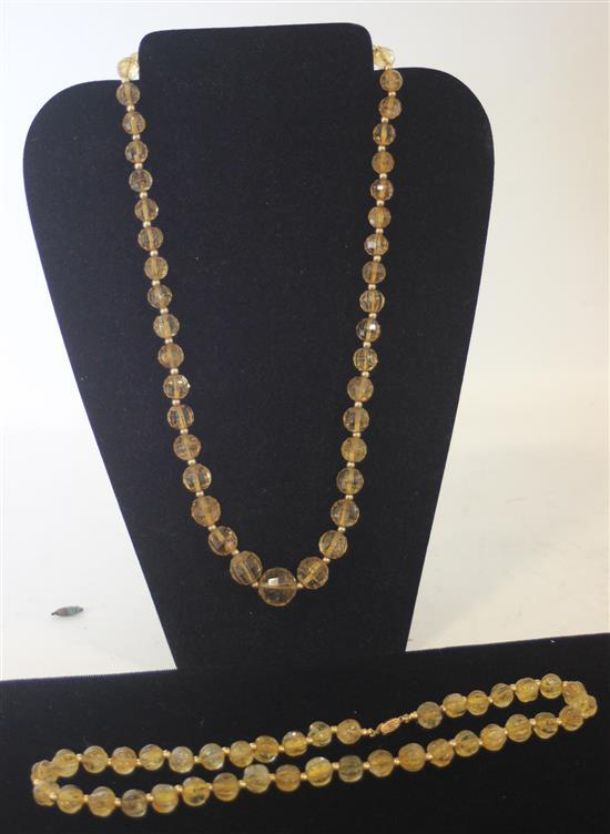 TWO AMBER TONE TOPAZ AND 14KT GOLD BEADED NECKLACE STRANDS. 24