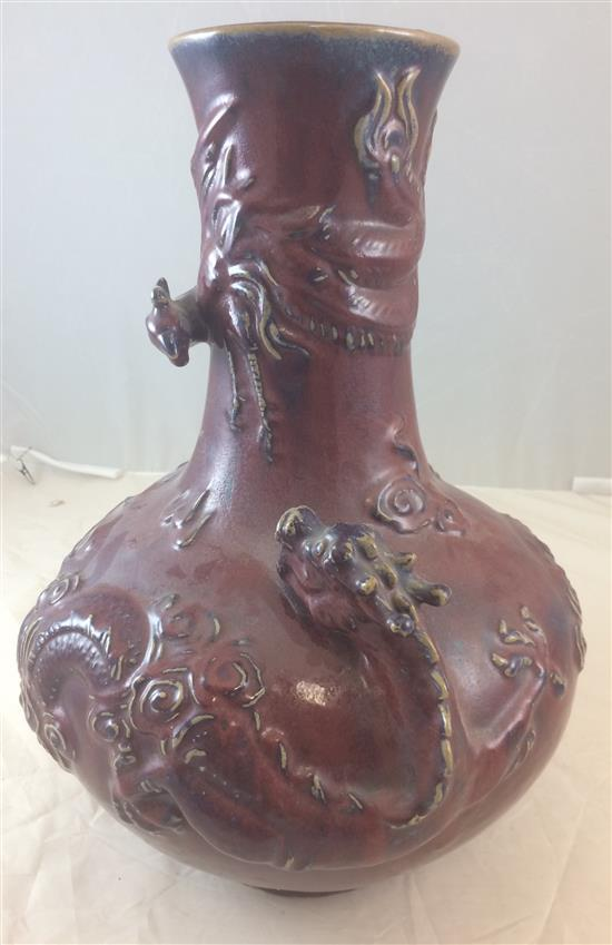 CHINESE RED GLAZED STONEWARE FLOOR VASE WITH DRAGONS IN RELIEF, 18