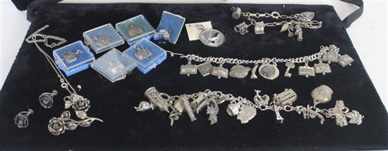 CHARM BRACELETS WITH CHARMS INCLUDING SOME STERLING SILVER AND LOOSE STERLING SILVER CHARMS