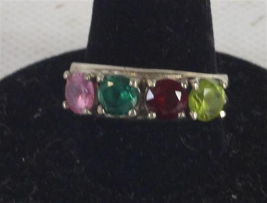 MARKED 10KT SIZE 7 BIRTHSTONE RING WITH FOUR PRONG SET MOUNTED STONES. 4.2 GRAMS TW.