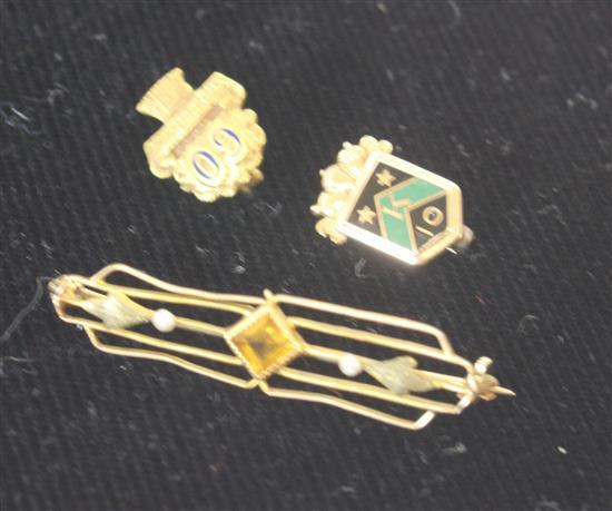 THREE MARKED 10KT GOLD PINS INCLUDING: SMALL PIN WITH SHIELD MOTIF, 60 YEAR SERVICE PIN, OPENWORK PIN WITH BEZEL SET SQUARE CUT AMBE...